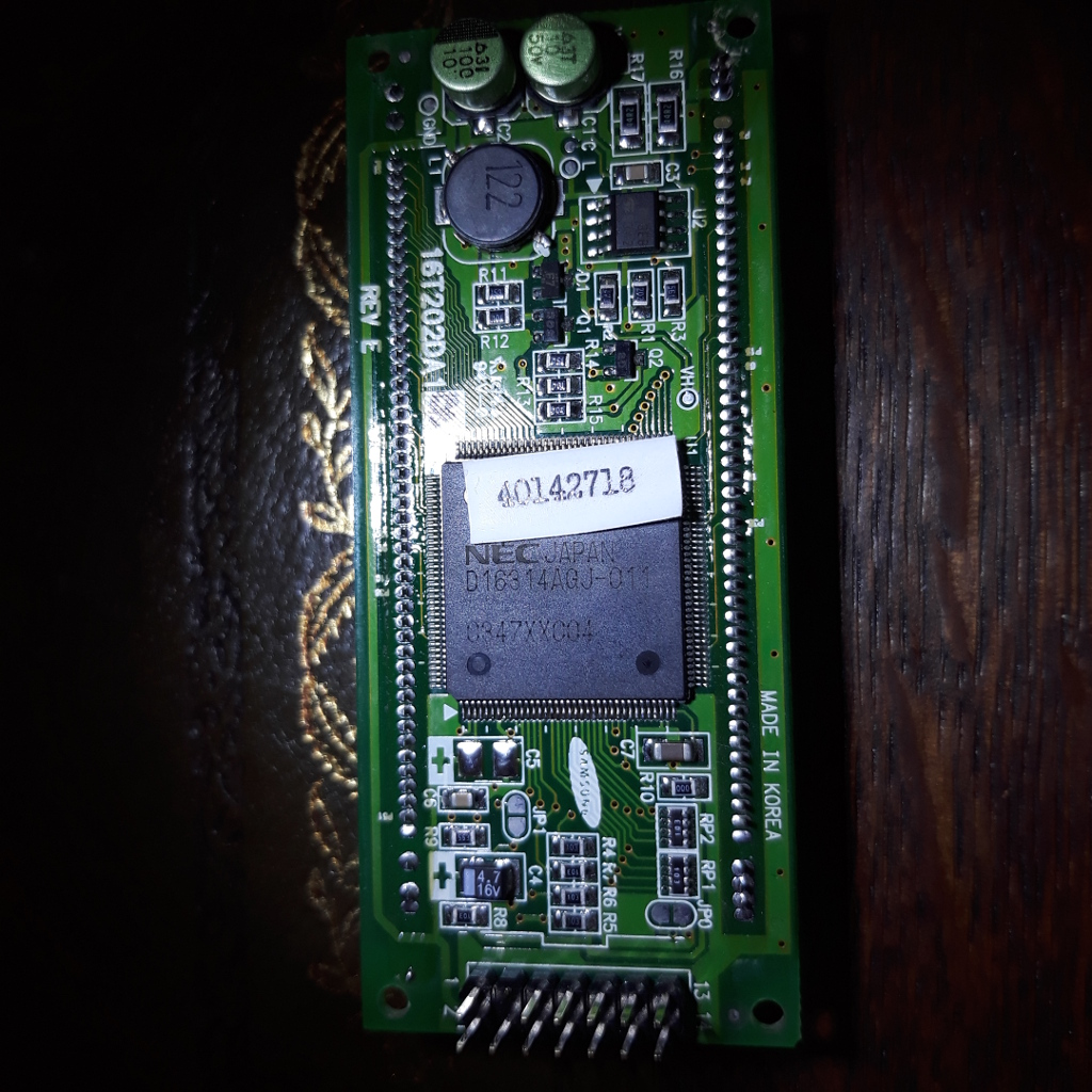 The NEC µPD16314 VFD is clearly visible on the back of the LCD